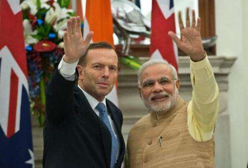Indian Prime Minister Narendra Modi (R) with Australian Prime Minister Tony Abbott (L) after signing a pact to supply uranium to
