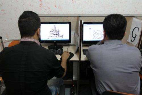 Iranians use computers at a cybercafe in central Tehran. Authorities are developing a system to identify any Internet user in th