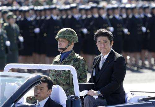 Japan OKs easing of military-related exports