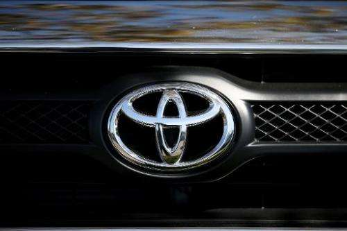 Japan's eight carmakers have joined forces to develop environmentally friendly engines to stave off fierce competition from fore