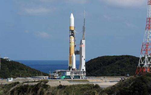 Japan's H-IIA rocket moves to the lauching pad at the Japan Aerospace Exploration Agency (JAXA) Tanegashima Space Center in Kago