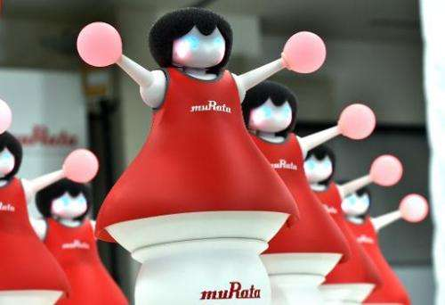 Japan's Murata Manufacturing unveils 10 small cheerleading robots, in Tokyo on September 25, 2014