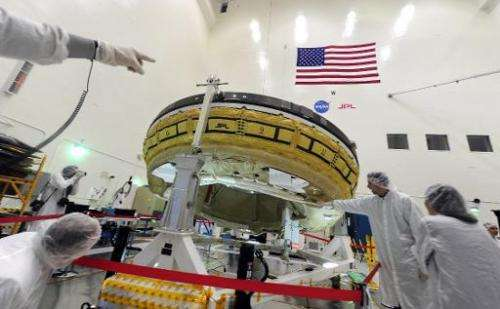 Journalists at NASA's Jet Propulsion Laboratory in Pasadena, California are shown April 9, 2014, a rocket-powered, flying saucer