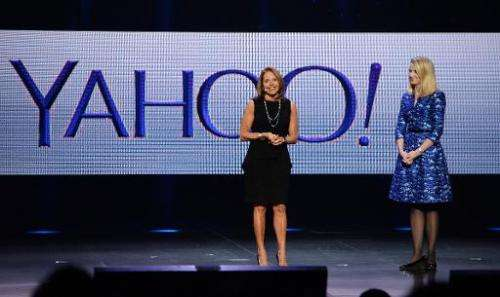 Katie Couric (L) appears on stage with Yahoo CEO Marissa Mayer during Mayer's keynote address at  the 2014 International CES in