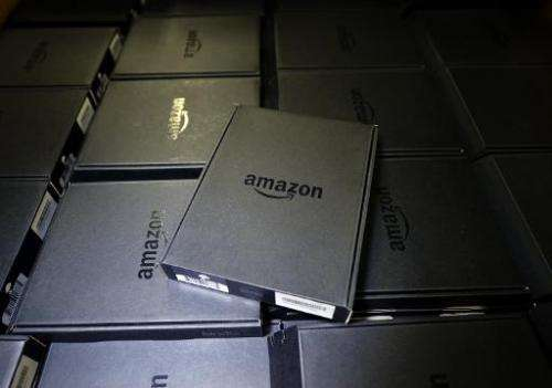 Kindle electronic readers are stacked at Amazon's San Bernardino Fulfillment Center on October 29, 2013 in San Bernardino, Calif