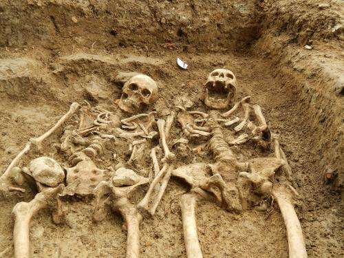 'Lost chapel' skeletons found holding hands after 700 years