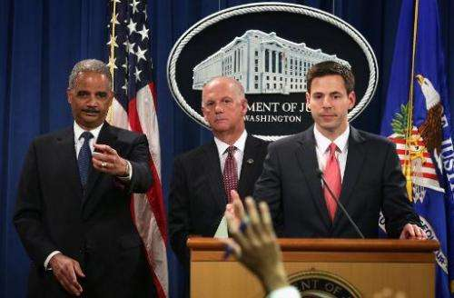 L-R: US Attorney General Eric Holder, US Attorney for Western District of Pennsylvania David Hickton, and Assistant Attorney Gen