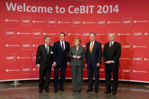 (L to R) President of BITKOM Dieter Kempf, British Prime Minister David Cameron, German Chancellor Angela Merkel, State Premier