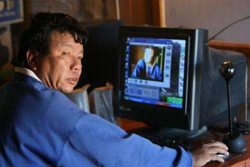 Mahabir Pun uses his computer in Nagi, 200 km west of Kathmandu, on October 25, 2010