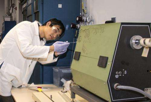 Material scientist exploring ways to improve efficiency of solar cells