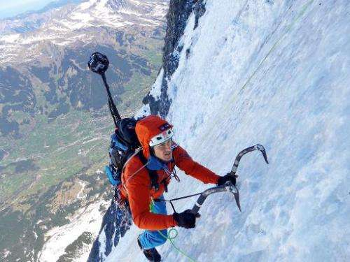 Mountaineer Daniel Arnold climbs the Eiger's north face with a custom-made camera mounted on his backpack, in Switzerland, on Ap