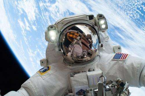NASA photo shows on December 24, 2013, NASA astronaut Mike Hopkins, in the second of two spacewalks outside the  International S