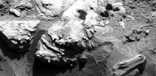 Nasa's Curiosity rover drills sandstone slab on Mars