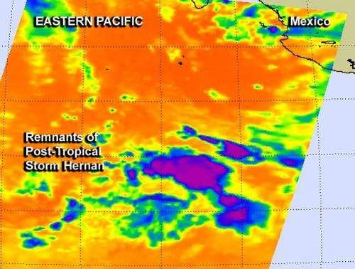 NASA sees warmer cloud tops as Tropical Storm Hernan degenerates