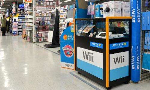 Nintendo's video game console Wii U is displayed at an electronics shop in Tokyo on January 20, 2014