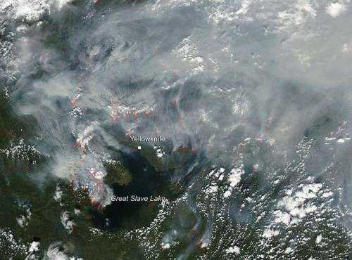 Northwest Territories on fire and smoke drifts over Labrador Sea