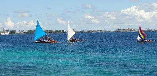 Outrigger canoes are shown near the Marshall Island's capital  Majuro on September 3, 2013
