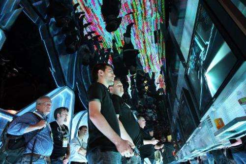 People try out the Disney TRON game at the annual Electronic Entertainment Expo (E3) at the Los Angeles Convention Center on Jun