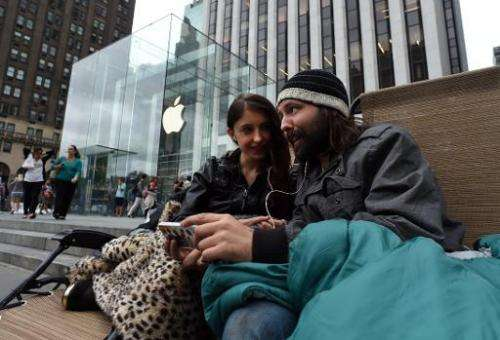 People wait in line September 9, 2014 outside the Apple Store in New York