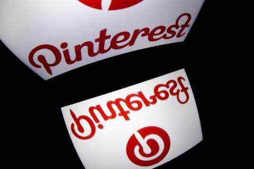 Pinterest's mobile app logo is displayed on a tablet on January 2, 2014 in Paris