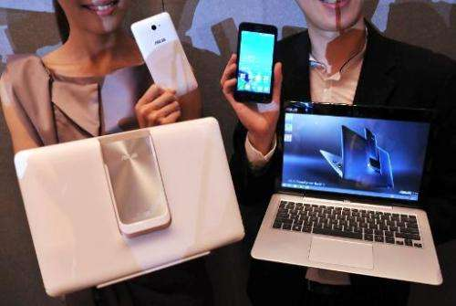 """Promoters display the new """"ASUS Transformer Book V"""" by Taiwanese electronics company ASUS during a press conference ah"""