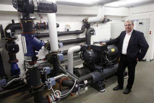 Robert Simmer is pictured in front of a heat pump on May 7, 2014 in Amstetten, Austria