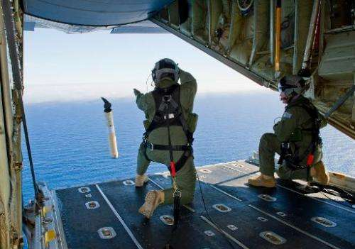 Royal Australian Air Force crew launch a Self Locating Data Marker Buoy from a C-130J Hercules during a search for flight MH370