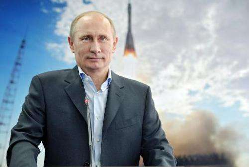 Russian President Vladimir Putin attends a communication session with the International Space Station from the construction of t