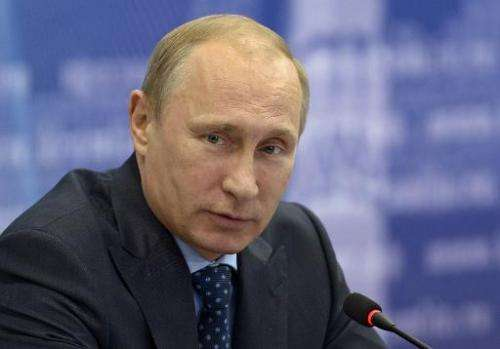 Russia's President Vladimir Putin attends a meeting in the Volga River region of Samara, on July 21, 2014