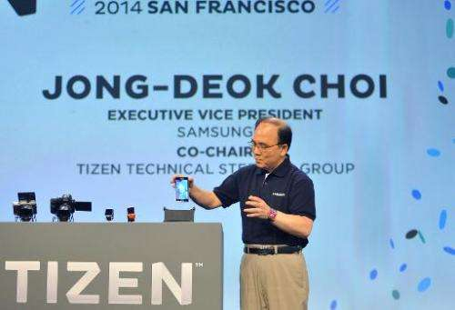 Samsung Executive Vice President Jong-Deok Choi displays the first Tizen Smartphone at the Tizen Developer Conference in San Fra