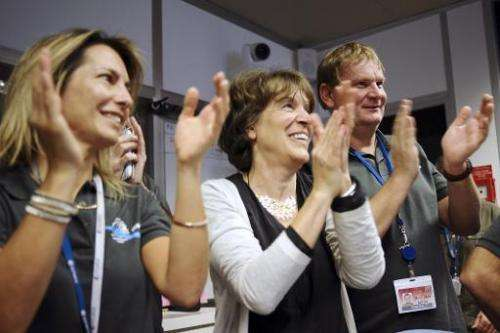 -Scientists celebrate at the French space agency Centre National d'Etudes Spatiales (CNES) in Toulouse, France, on November 12,