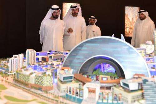 """Sheikh Mohammed bin Rashid al-Maktoum looks at the mock-up of the """"Mall of the World"""" project during its presentation"""