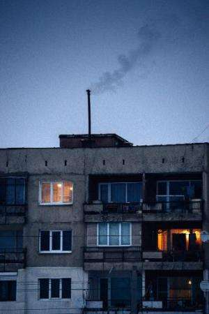 Smoke rises from the chimney of an apartment building in Pernik on January 28, 2014