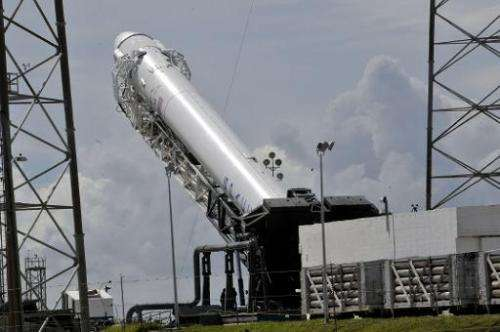 SpaceX's Falcon 9 rocket with the Dragon space craft are readied on October 7, 2012 for an evening launch from Cape Canaveral, F