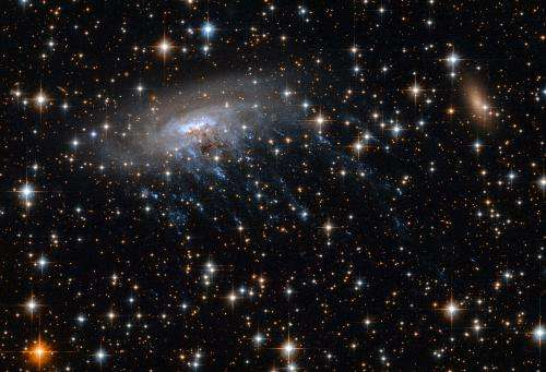 Spiral galaxy spills blood and guts