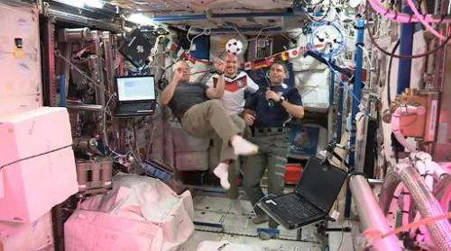 Still image taken June 13, 2014 from a NASA video shows US astronauts Reid Wiseman (L) and Steve Swanson (R) and  German astrona
