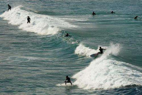 Surfers enjoy the waves at Bondi Beach, Sydney's most famous beach, on June 10, 2013
