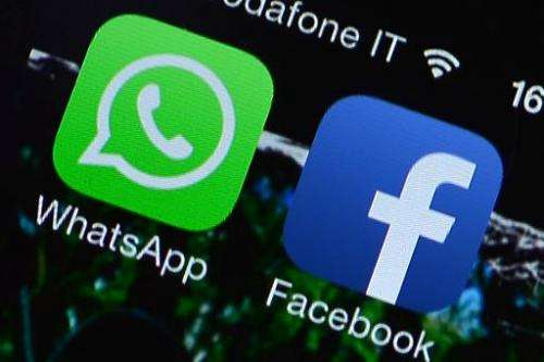 The Facebook and WhatsApp applications are displayed on a smartphone on February 20, 2014 in Rome