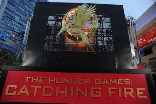 "The flaming logo for the Los Angeles premiere of ""The Hunger Games: Catching Fire"" is seen at the Nokia Theatre LA Liv"