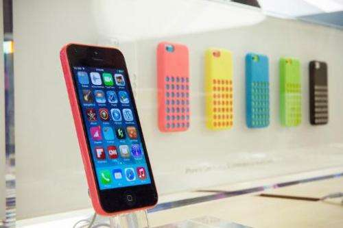 The iPhone 5C is displayed at the Fifth Avenue Apple store in New York City on September 20, 2013