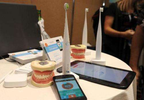 "The Kolibree toothbrush, the world's first Internet-connected toothbrush, is displayed at the ""CES: Unveiled,"" media p"