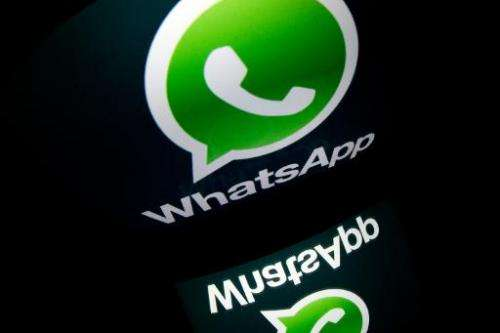 "The logo of mobile app ""WhatsApp"" is displayed on a tablet on January 2, 2014 in Paris"