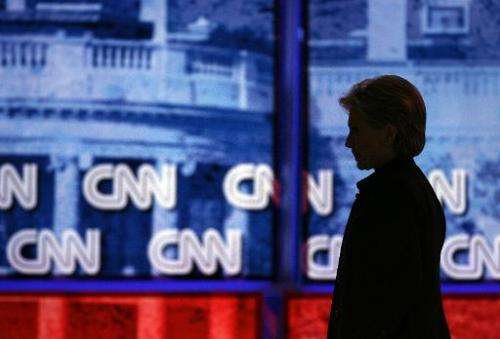 Then-senator Hillary Clinton is silhouetted off stage during a debate on January 31, 2008