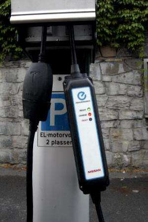 The plugs of charging cars are seen in free parking spaces for electric cars in central Oslo on August 19, 2014