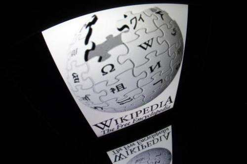 """The """"Wikipedia"""" logo is seen on a tablet screen on December 4, 2012 in Paris"""