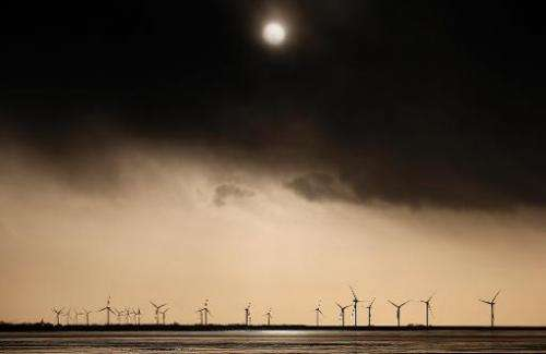 The sun is seen through dark clouds in Klanxbuell, northern Germany, on December 7, 2013