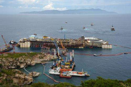 The wreck of the Costa Concordia cruise ship during an operation to refloat the boat on July 14, 2014 off the Giglio Island