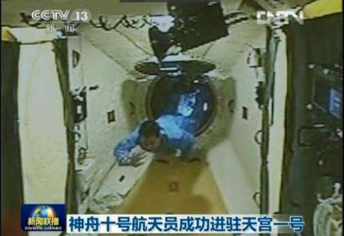 This frame grab taken from China Central Television (CCTV) on June 13, 2013 shows a scene broadcast of Chinese astronaut Nie Hai
