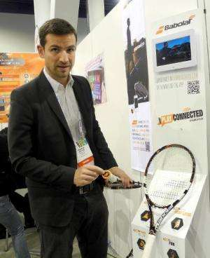 Thomas Otton, global communications director for the French tennis equipment maker Babolat, shows the company's new 'connected'