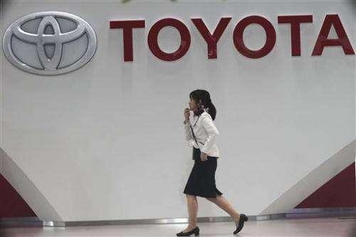 Toyota raises forecast on profit jump, weak yen
